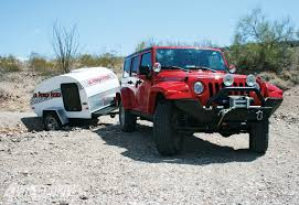 jeep offroad trailer teardrop or tent trailer behind jeep wrangler adventure rider