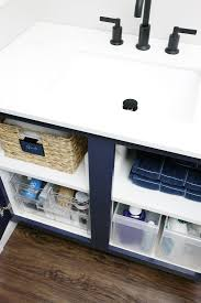 how to organize the sink cabinet iheart organizing doubling up on the sink storage space