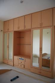 Space Saving Closet Ideas With A Dressing Table Modern And Fancy Bedroom Wardrobes And Closets Beautiful Plywood