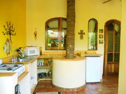 nice yellow mexican kitchen with hardwood cabinets also decorative