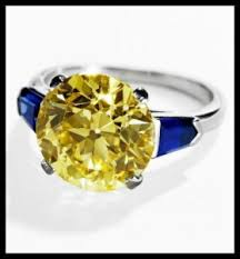 art deco cartier yellow diamond and sapphire ring it features a
