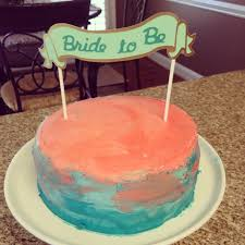 coral and turquoise bridal shower with swirl cake