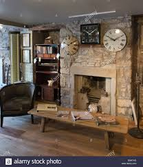 old cottage stone walls and two fireplaces exposed during