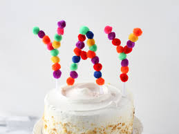 in cake toppers this diy pom pom cake topper is so festive easy