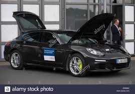electric porsche panamera the bonnet and trunk of a porsche panamera e hybrid are open during