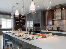 interior glass pendant lighting with round gray stools and long
