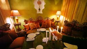 Subjects Of Interior Designing Man Lights Candles On Decorated Table Among Subjects Of East Decor