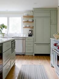 green kitchen cabinets with white island beautiful kitchen features green cabinets paired with