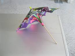 How To Make Paper Umbrellas - how to make a paper umbrella using posters and office supplies 11