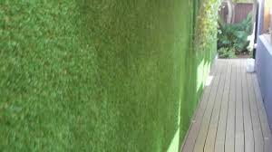 Garden Wall Systems by Vertigrass Modular Synthetic Grass System Installed On Exterior