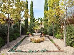 mediterranean garden with rocks and trees creating a