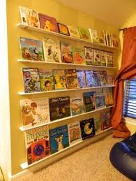 Vinyl Rain Gutter Bookshelves - rain gutter book shelves behind a door galvanized paint buckets