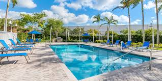 dutch west indies estate tropical exterior miami holiday inn express suites miami kendall hotel by ihg