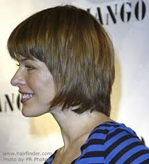 bib haircuts that look like helmet milla jovovich with her hair cut in a sleek short style with