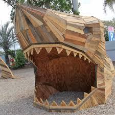 a giant wooden recycled shark at carrara markets gold coast abc