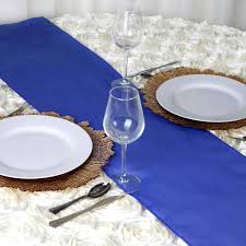a beautiful table setting with royal blue tablecloth home