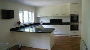 modern gloss white kitchen in ascot berkshire with karndean