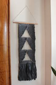 decorating small gray tapestry wall hangings with white paint
