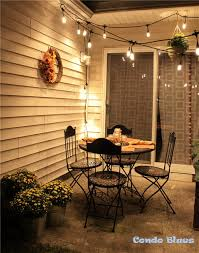 Patio Cafe Lights by Condo Blues How To Decorate A Small Patio For Fall