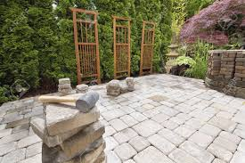 stack of brick pavers for hardscape in backyard landscaping with