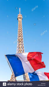 French Flag Eiffel Tower A French Flag Flies In Front Of The Eiffel Tower In Paris France