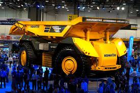 komatsu unveils autonomous haulage vehicle a mining truck that