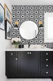 black bathroom vanity with white quartz counter transitional
