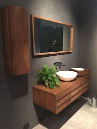 bathroom wall mounted wood vanity and storage also modern