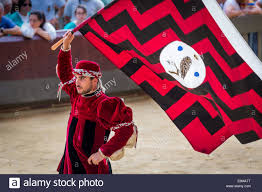 Palio Di Siena Flags Man Carrying A Flag From The Little Owl Contrade Historical