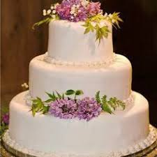 osted wedding cakes uncover tiers of lavish sponge and not much