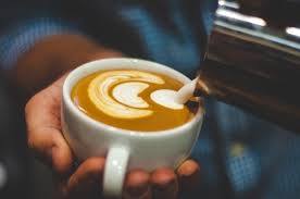 how to make designs on coffee how does a barista make designs in coffee quora