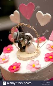 decorated wedding cake with cute teddy bear figurines and candy