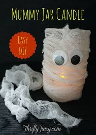 Fun Halloween Crafts - mummy jar candle diy a fun halloween craft thrifty jinxy