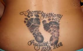 butterfly tattoo with baby footprint memorial footprints lower back tattoo
