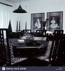 Animal Print Chairs Living Room by Black White Animal Print Cushions On Black Chairs At Black Table