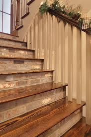 traditional staircase with high ceiling hardwood floors in