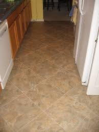 pictures of tiled kitchen floors with cabinetry also island and
