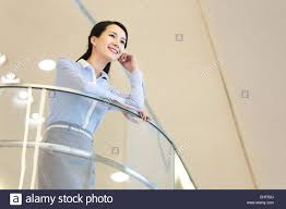The Banister The Leisure Business Women Leaned Over The Banister Stock Photo