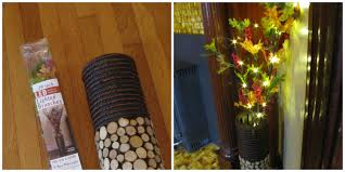 decorating lighted branches with pretty black vase for home