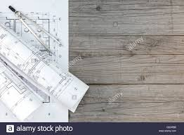 architect workspace with floor plan and drawing compass on gray