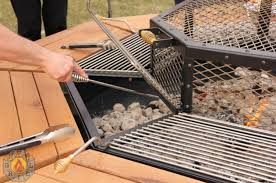 fire pit grill table combo this fire pit grill and table combo is every man s dream fire pit