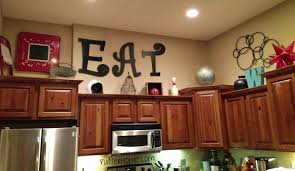 top of kitchen cabinet decor ideas decorations for above kitchen cabinets photogiraffe me