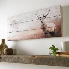stag print on wood wall wall uk graham brown