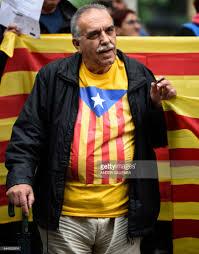 a man holds a u0027estelada u0027 pro independence catalan flag as he