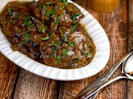 slow cooker chopped steak with onion mushroom gravy the midnight