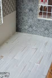 diy herringbone wood floors and fabric wallpaper dollhouse updates