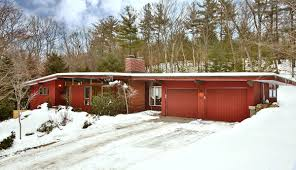 Midcentury Modern House - exterior three mid century modern homes with red wall and snow