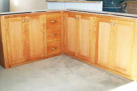 Buy Unfinished Kitchen Cabinets by Light Brown Wooden Cabinet With Many Storage And Drawers Placed On