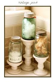 bathroom countertop decorating ideas i like this so they just aren t jars sitting on the counter