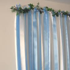 wedding backdrop blue blue ribbon backdrop on white pole with garland by just add a